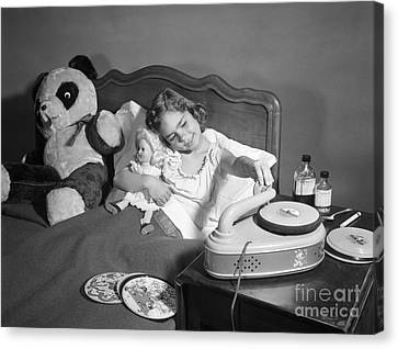Sick Girl Playing Records, C.1950s Canvas Print by Debrocke/ClassicStock