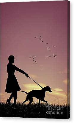 Silhouette Of Woman Walking Her Dog Canvas Print by Amanda Elwell