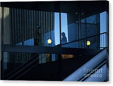 Silhouetted Woman In Business Complex Canvas Print
