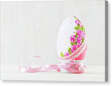 Single Easter Egg On Wooden Table. Decoupage Art Canvas Print by Michal Bednarek
