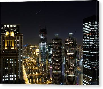 Chicago River Canvas Print - Skyscrapers In A City Lit Up At Night by Panoramic Images
