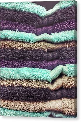 Stack Of Colourful Towels Canvas Print by Tom Gowanlock