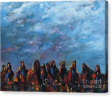 Stampede Canvas Print by Frances Marino