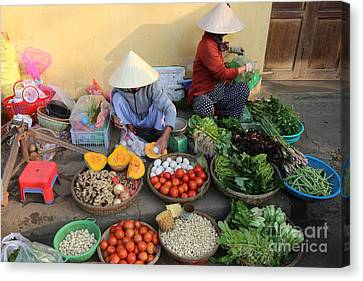 Street Merchants Hoi An Canvas Print by Chuck Kuhn
