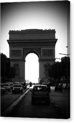 Streets Of Paris Canvas Print by Kamil Swiatek