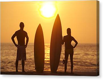 Two Waves Canvas Print - Surfer Silhouettes by Larry Dale Gordon - Printscapes