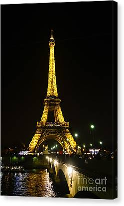 The Eiffel Tower At Night Illuminated, Paris, France. Canvas Print by Perry Van Munster