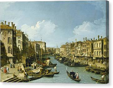 The Grand Canal Near The Rialto Bridge, Venice Canvas Print by Canaletto