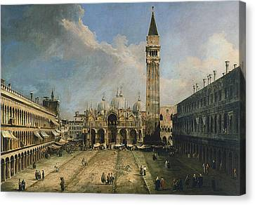 The Piazza San Marco In Venice Canvas Print by Canaletto