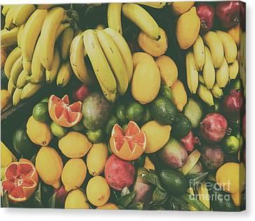Tropical Summer Fruits In Fruit Market Canvas Print by Radu Bercan