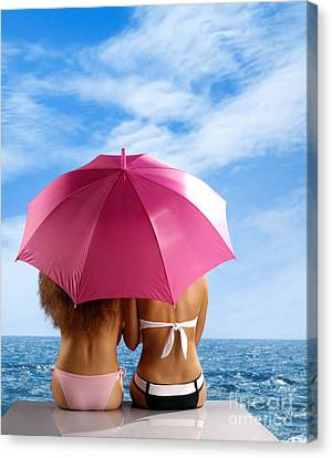 Two Women Relaxing On A Shore Canvas Print