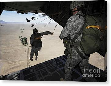 U.s. Airmen Jump From A C-130 Hercules Canvas Print by Stocktrek Images