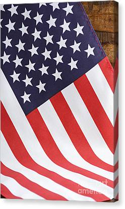 American Independance Canvas Print - Usa Stars And Stripes Flag On Dark Wood by Milleflore Images