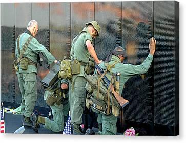 Veterans At Vietnam Wall Canvas Print