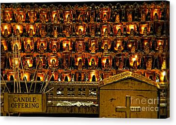 Votive Candles Canvas Print by John Greim