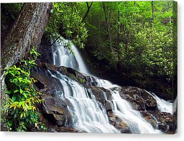 Water Cascading Over Rocky Cliffs Canvas Print by Panoramic Images
