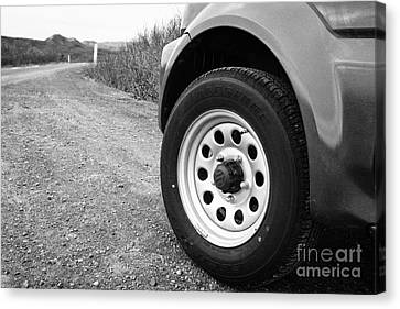 Wheel Of Small 4x4 Vehicle Driving On Gravel Road Onto Main Road Reykjavik Iceland Canvas Print