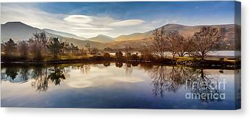 Winter Reflections Canvas Print by Adrian Evans