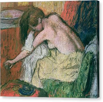 Woman Drying Herself Canvas Print by Edgar Degas