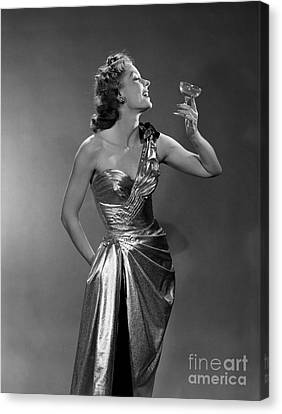 Woman In Metallic Dress, C.1950s Canvas Print by Debrocke/ClassicStock