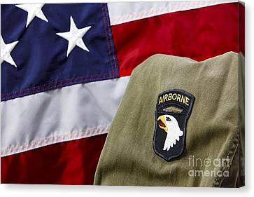 101st Airborne Division Screaming Eagles Patch On Vietnam Era Uniform In Front Of United States Of America Flag Canvas Print by Joe Fox