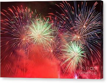 Spectacular Fireworks Show Light Up The Sky. New Year Celebration. Canvas Print by Michal Bednarek