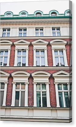Apartment Building Canvas Print by Tom Gowanlock