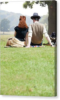 Canvas Print featuring the photograph 1940s Couple Sitting In The Sunshine by Lee Avison