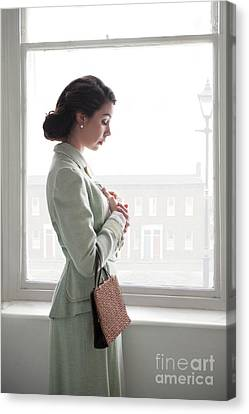 Canvas Print featuring the photograph 1940s Woman At The Window by Lee Avison