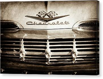 Canvas Print featuring the photograph 1959 Chevrolet Impala Grille Emblem -1014s by Jill Reger