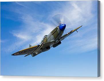 A Supermarine Spitfire Mk-18 In Flight Canvas Print by Scott Germain