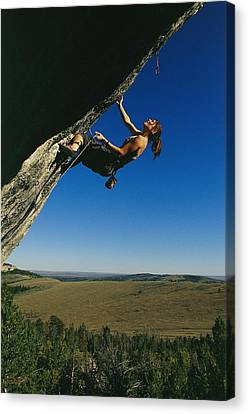 A Young Woman Climbing The Rock Feature Canvas Print by Bobby Model