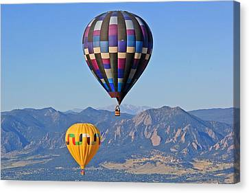2 Balloons Flying Over The Flatirons Canvas Print by Scott Mahon