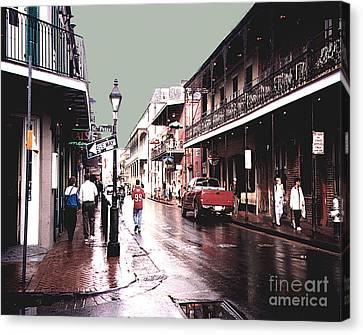 Bourbon Street After The Rain Canvas Print by Merton Allen
