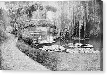Claude Monet In His Garden At Giverny Canvas Print by French School