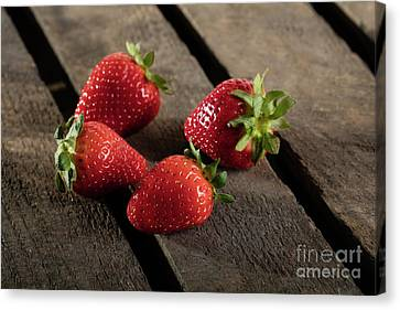Four Strawberries Canvas Print - Four Juicy Strawberry On Wooden Plank by Piotr Marcinski