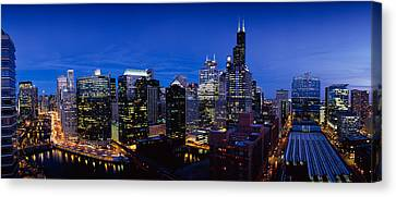 Chicago River Canvas Print - High Angle View Of Skyscrapers Lit by Panoramic Images