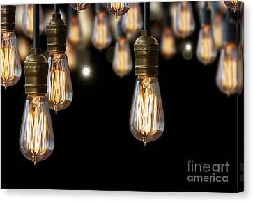 Light Bulb Background Canvas Print by Setsiri Silapasuwanchai