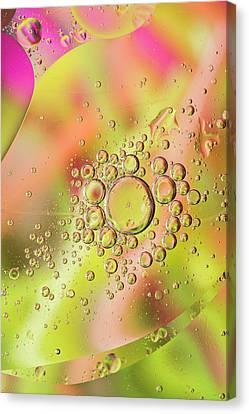 Canvas Print featuring the photograph Oil In Water by Kevin Blackburn