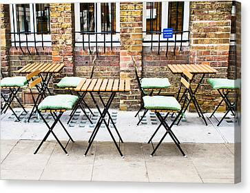 Empty Chairs Canvas Print - Pavement Cafe by Tom Gowanlock