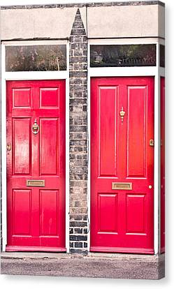 Red Doors Canvas Print by Tom Gowanlock