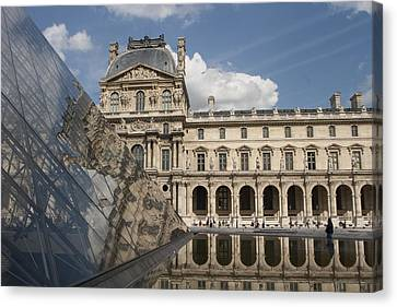 Reflection Of The Louvre Canvas Print by Carl Purcell
