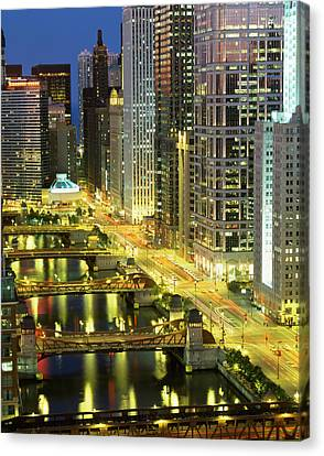 Chicago River Canvas Print - Skyscrapers Lit Up At Night, Chicago by Panoramic Images