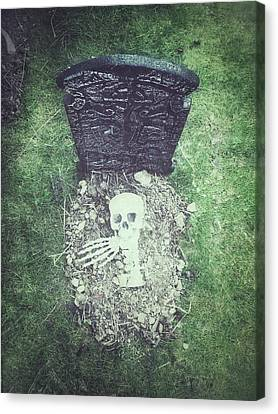 Spooky Grave Stones Canvas Print by Tom Gowanlock