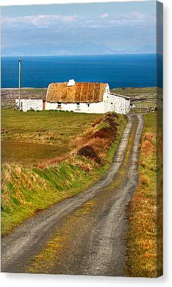 Thatch Roof Cottage Ireland Canvas Print by Pierre Leclerc Photography