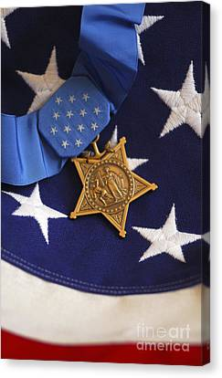 The Medal Of Honor Rests On A Flag Canvas Print by Stocktrek Images
