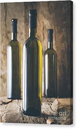 Wine On Wood Canvas Print by Mythja Photography