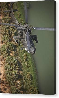An Ah-64d Apache Helicopter In Flight Canvas Print by Terry Moore
