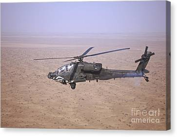 An Ah-64d Apache Longbow Fires A Hydra Canvas Print by Terry Moore