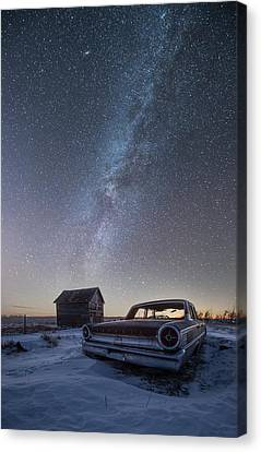 3 Galaxies  Canvas Print by Aaron J Groen